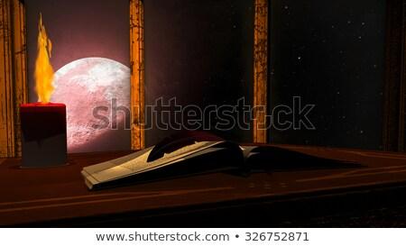 Open antieke boek brandend kaars Rood Stockfoto © ankarb