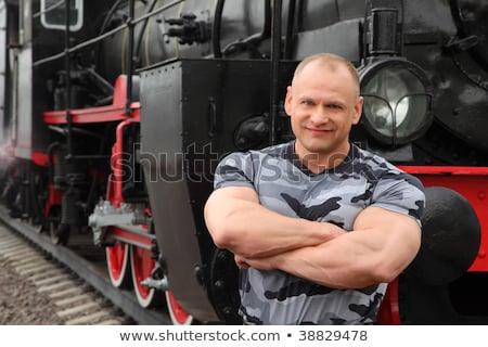 Silne człowiek lokomotywa uśmiechnięty ręce metal Zdjęcia stock © Paha_L