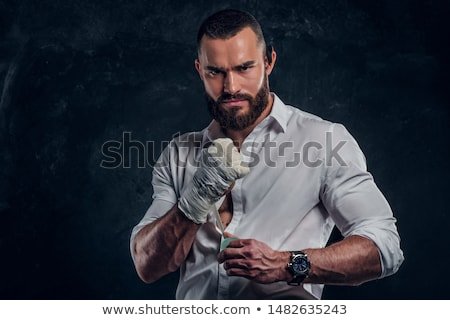athletic attractive man wearing boxing bandages on the white stock photo © vlad_star