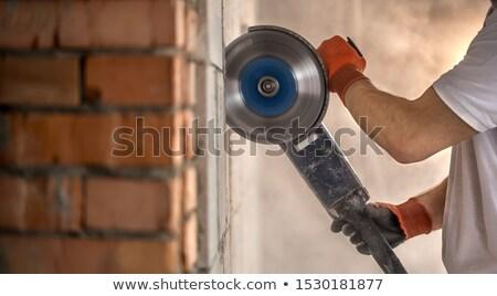 Duvar oluşturucu işçi öğütücü makine Stok fotoğraf © shime