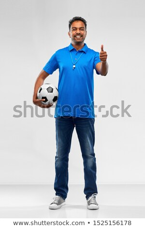 Homme bleu polo victoire signe Photo stock © feedough