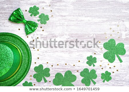 green shamrock clovers on white wooden background stock photo © vlad_star