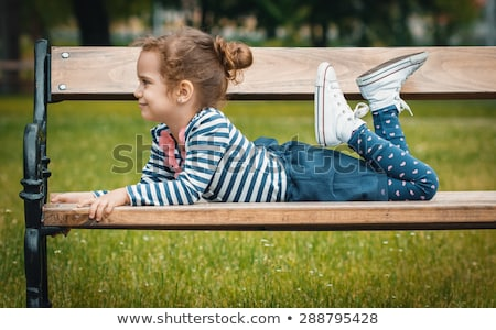 Girl lies on the bench Stock photo © bezikus
