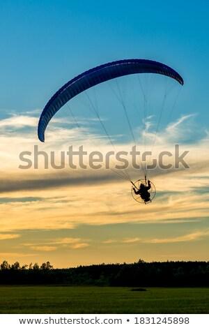 Siklórepülés sziluett naplemente illusztráció Stock fotó © adrenalina