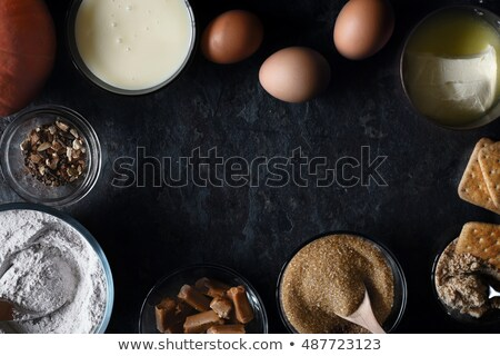 Frame of ingredients  for  pumpkin dump cake on the dark stone background top view Stock photo © Karpenkovdenis