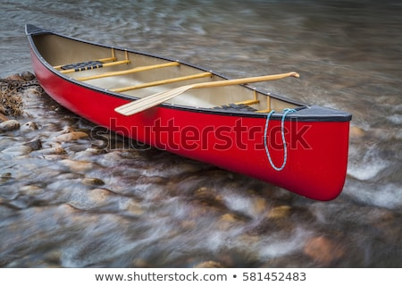 red canoe on a shallow rocky river Stock photo © PixelsAway