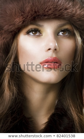 beautiful brunette with glamour earings and winter fur Stock photo © zdenkam