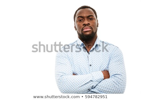 Serious young african man standing with arms crossed stock photo © deandrobot