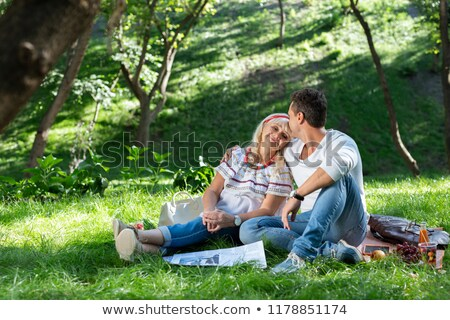 delighted mother with her son outdoors in a park stock photo © tommyandone
