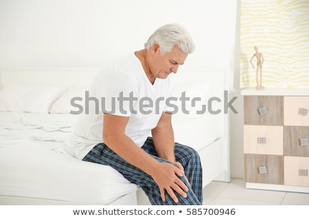 Man suffering with knee inflammation Stock photo © wavebreak_media