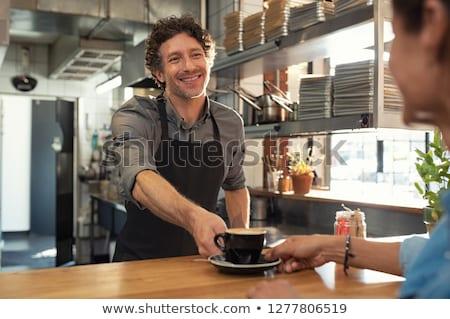 waiter serving coffee to customer at counter stock photo © wavebreak_media