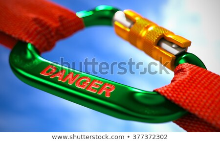 Danger on Green Carabiner between Red Ropes. Stock photo © tashatuvango