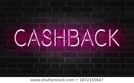 Online Payment on Dark Brick Wall. Stock photo © tashatuvango