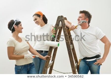 group of friends painting wall stock photo © is2
