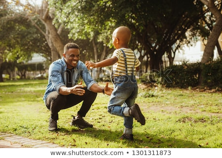 boy running into father's arms Stock photo © IS2