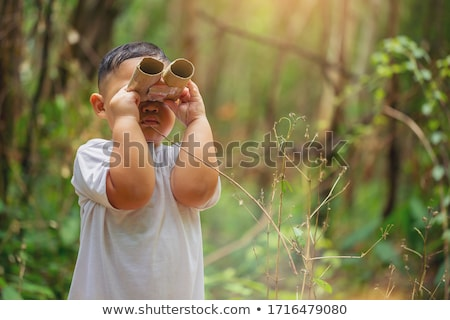 Boy with binocular Stock photo © Massonforstock