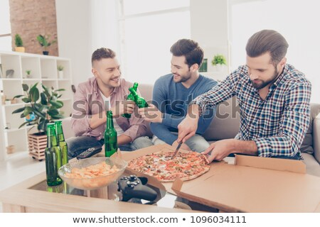 3 men sitting at table smiling Stock photo © IS2