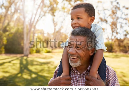 Grandfather with boy on shoulders Stock photo © IS2