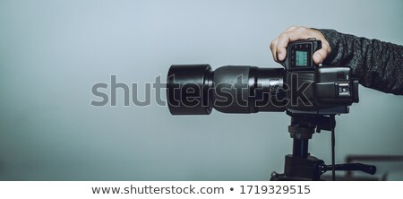photographer holding full frame sensor dslr camera stock photo © stevanovicigor
