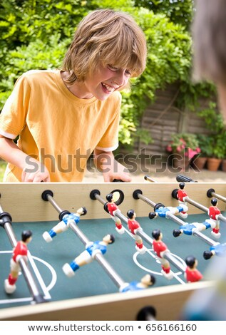 Boy (10-12) playing table football Stock photo © IS2