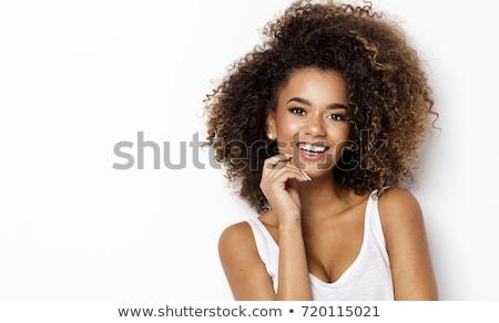 perfil · sonriendo · jóvenes · mujer · negro · atractivo - foto stock © is2