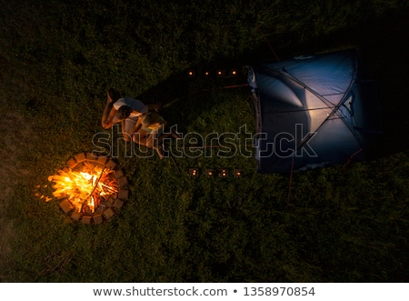 Couple at campsite cooking hotdogs Stock photo © IS2