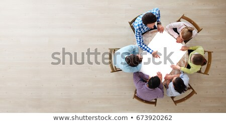 Creative business team pointing to a blank copy space on table Stock photo © wavebreak_media