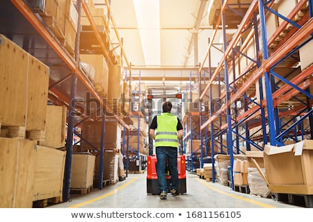 loader with clipboard in forklift at warehouse Stock photo © dolgachov