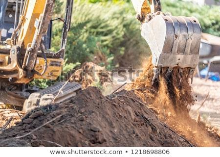 Trabalhando escavadora trator trincheira construção Foto stock © feverpitch