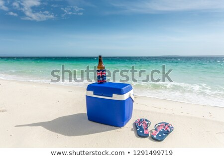 Esky thongs and a cold drink on the beach in Australia Stock photo © lovleah