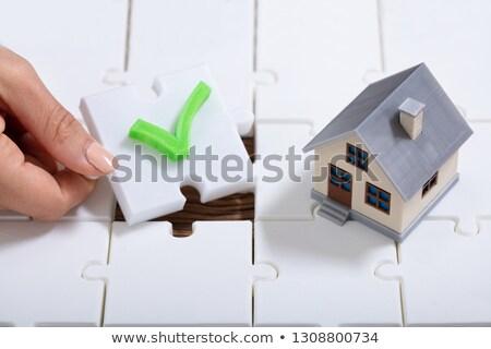 Pessoa peças do puzzle casa modelo Foto stock © AndreyPopov