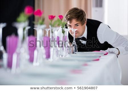 Gut aussehend jungen Kellner Smoking halten Platte Stock foto © deandrobot