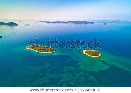 lonely stone island in zadar archipelago aerial view stock photo © xbrchx