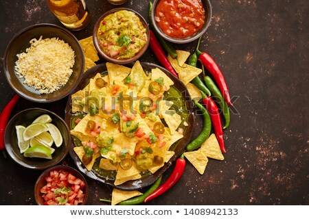 Tasty mexican nachos chips served on ceramic plate Stock photo © dash