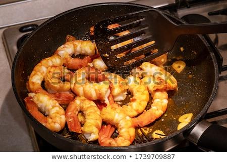 Grilled big tiger shrimps prawns on grill pan,  stock photo © Illia