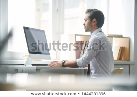 Serious broker concentrating on looking through online financial data Stock photo © pressmaster