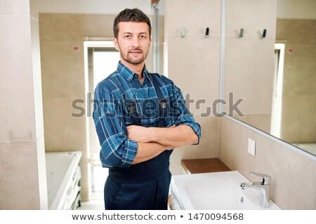 Fiatal sikeres vízvezetékszerelő munkaruha áll fürdőszoba Stock fotó © pressmaster