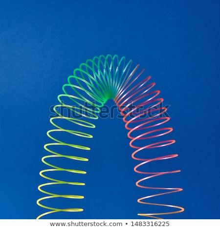 Stretching slinky toy in the shape of parabola. Stock photo © artjazz