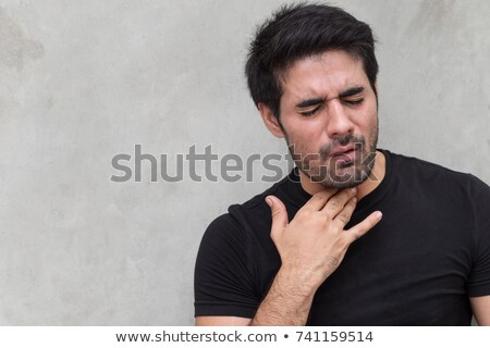 indian man suffering from neck pain or sore throat Stock photo © dolgachov