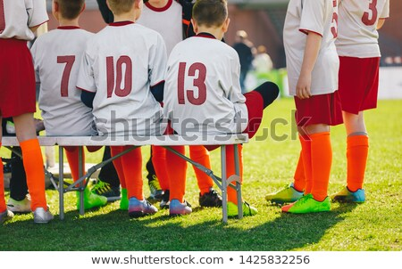 Csoport gyerekek ül sportok pad fű Stock fotó © matimix