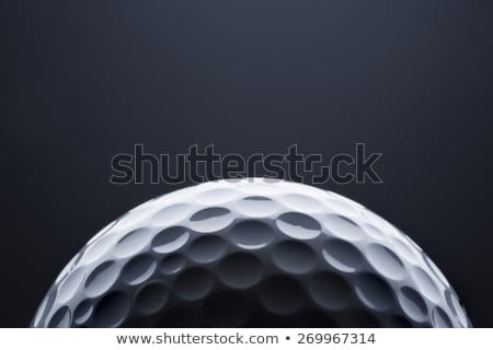 Golf ball isolated on dark background with space for text. Stock photo © lichtmeister