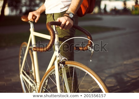 hipster man with fixed gear bike and backpack Stock photo © dolgachov