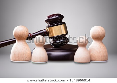 Wooden Pawns In Front Of Gavel And Mallet Stock photo © AndreyPopov