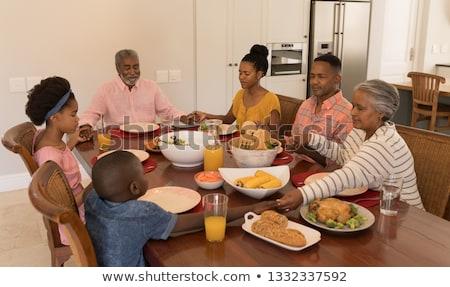 grup · insanlar · tablo · dua · eden · yemek · kahvaltı · aile - stok fotoğraf © wavebreak_media