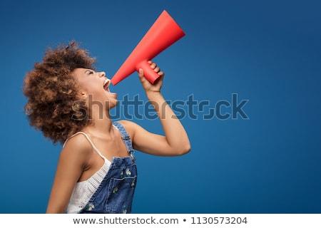 red haired teenage girl speaking to megaphone stock photo © dolgachov