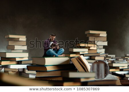 Big Book and Man Reading Information on Pages Stock photo © robuart