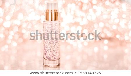 holiday make up base gel serum emulsion lotion bottle and rose stock photo © anneleven