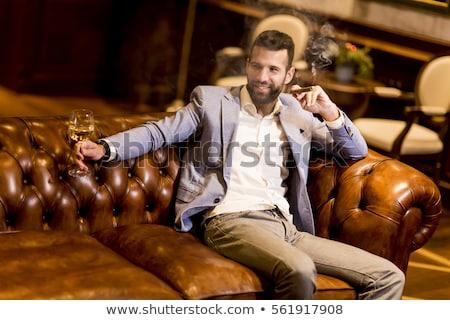 Młody człowiek białe wino palenia cygara przystojny Zdjęcia stock © boggy
