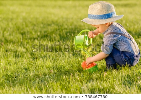 One happy boy with watering can Stock photo © bluering