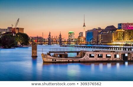 Folyó Berlin alkonyat ipar épületek Fernsehturm Stock fotó © elxeneize